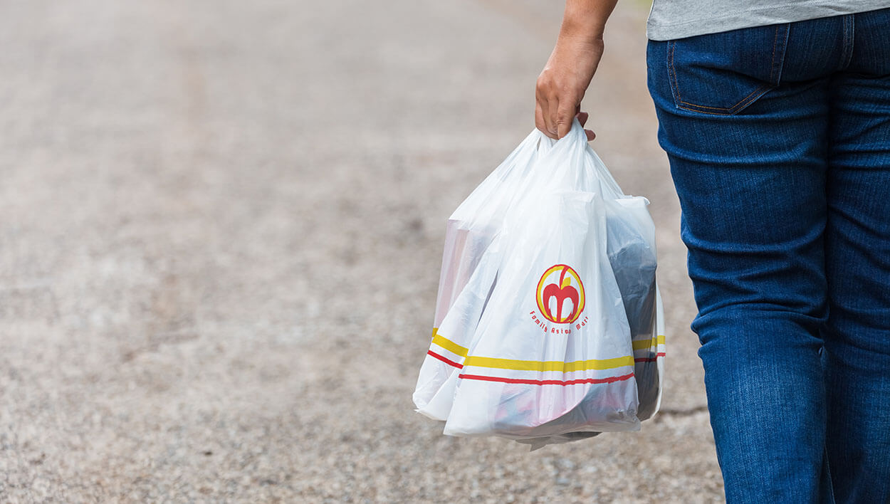 Plastic bag with Family Asian Mart logo designed by Meld Design and Production