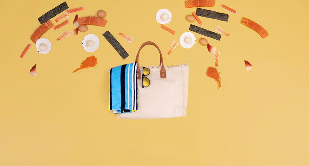 Sushi Hub ingredients flying into a beach bag