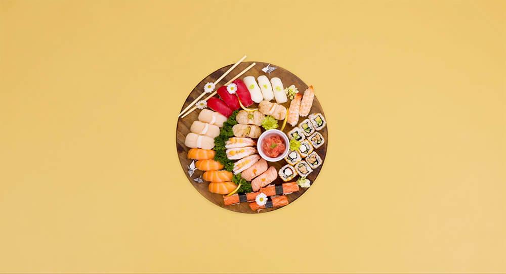 Sushi Hub salad platter on a yellow background